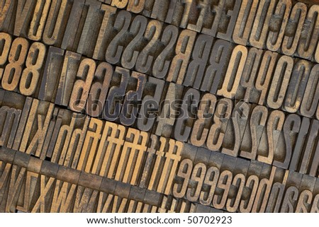 vintage well used wooden letterpress types, letters and numbers  (Gothic condensed), stained in ink