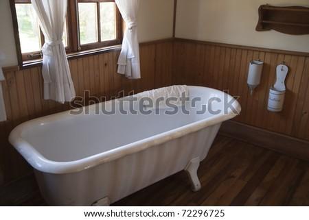 Vintage white bathtub in a bathroom - stock photo
