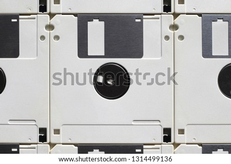 Vintage white floppy disks, placed side by side