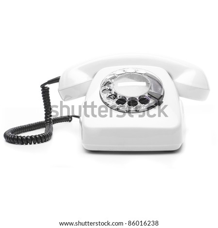 vintage white telephone isolated over white background