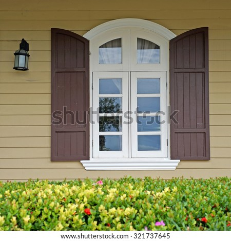 vintage window on wooden wall with beautiful flower