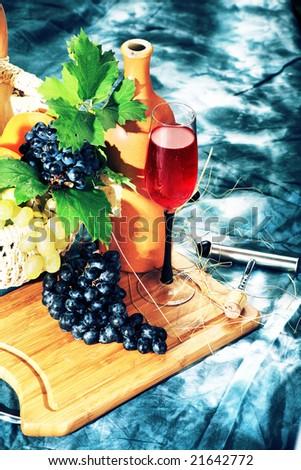 Vintage wine composition: vine and bottle of wine