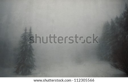 vintage winter landscape with spooky tree in fogy forest