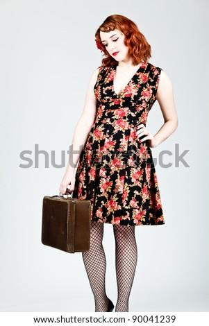 Vintage woman holding a suitcase