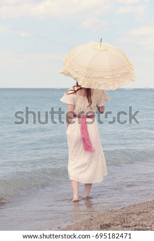 vintage woman on beach with...