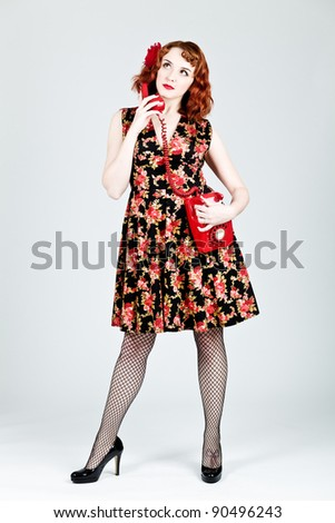 Vintage woman using a red phone