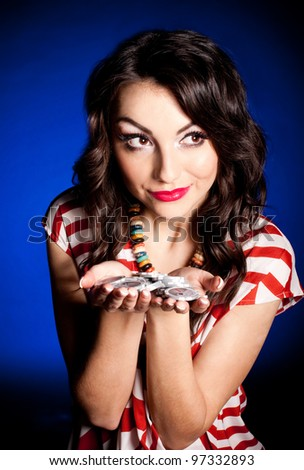 Vintage woman with casino chips on dark background