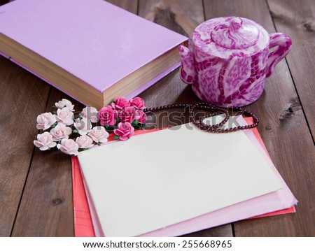 Vintage women\'s letter, book and teapot. Retro concept with dried flowers on a wooden background