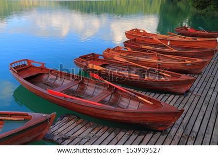 vintage wood boats floating on...