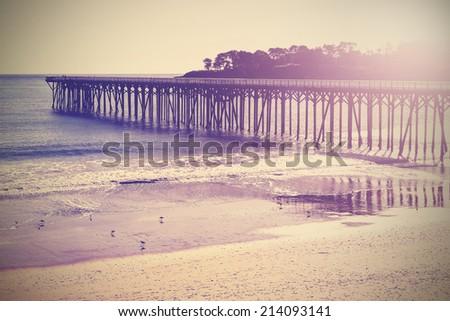 vintage wood bridge at beach...