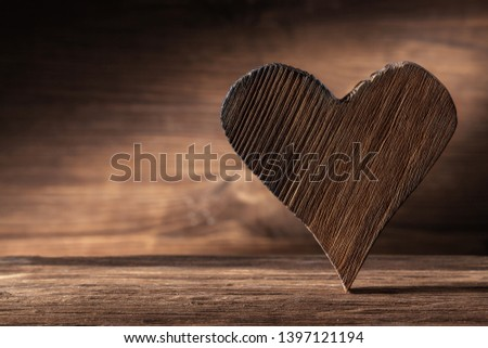 vintage wood heart on woode background close up