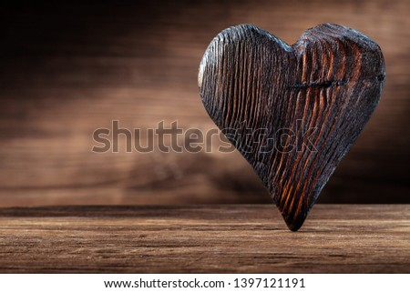 vintage wood heart standing on woden background