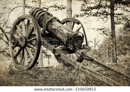 vintage wood heavy gun in forest; textured historical image
