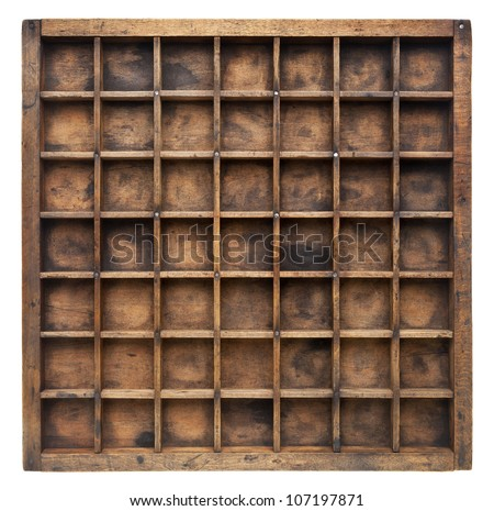 vintage wood  printer  (typesetter) drawer with numerous dividers, isolated on white - stock photo