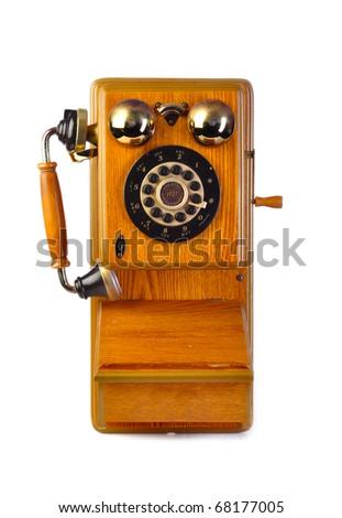 Vintage wood telephone isolated on white