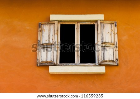 Vintage wood window on orange wall