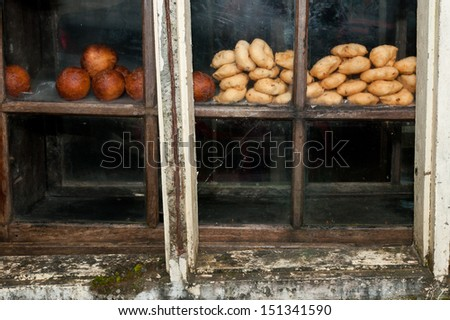 Vintage wooden and glass shelf used to store food.wood shelf. grunge industrial interior. Window shopping. old way of displaying food in hotels.