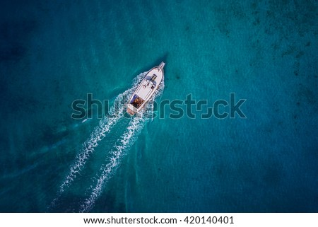 Vintage wooden boat in coral sea. Boat drone photo. stock photo
