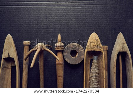 vintage wooden boat shuttles for hand weaving. The weft yarn is unwound from the tip of the pier when the shuttle is in motion and stops when the shuttle stops. spindle, manual spinning,  Photo stock ©