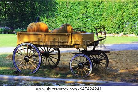 vintage wooden cart and pumpkin....
