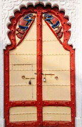 Vintage wooden Doors red yellow colour on it Elephant and Monkey mounting on the door