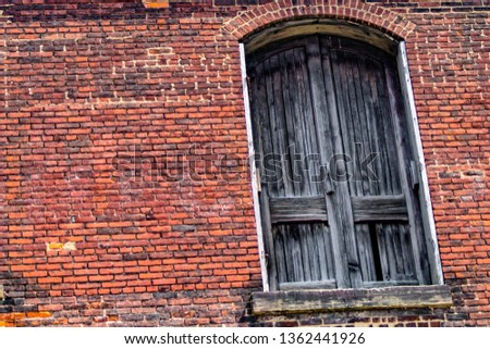 Vintage wooden doors to old red brick industrial buildings  in the Flats, Cleveland
