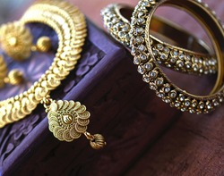 Vintage wooden jewellery box with Indian traditional jewelry, Golden pair of earrings, gold diamond bracelet Luxury female jewelry, Indian traditional jewellery,Bridal Gold wedding jewellery