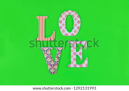 Vintage wooden love letters on green background with copy space. Romanticism concept. #1292131993