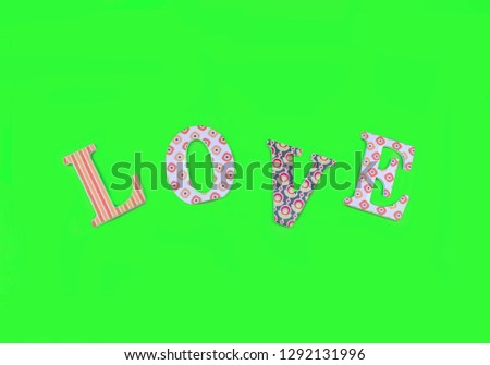 Vintage wooden love letters on green background with copy space. Romanticism concept. #1292131996