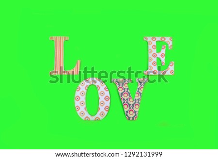 Vintage wooden love letters on green background with copy space. Romanticism concept. #1292131999
