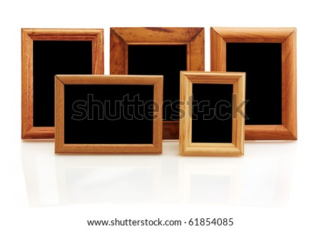 vintage wooden photo frames on white background with reflection
