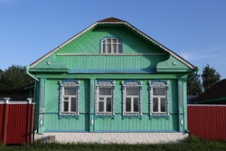 Vintage wooden rural house with ornamental windows, frames in Suzdal town, Vladimir region, Russia. Russian traditional national folk style in architecture. Suzdal landmark, view. Village, countryside