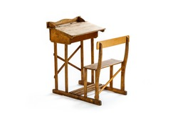 Vintage wooden school desk and chair isolated on white