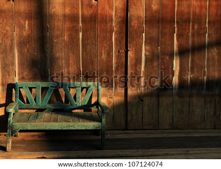 Vintage Wooden sofa with wood background