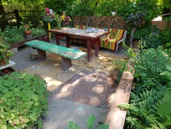 Vintage wooden table with benches in nature.