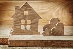 vintage wooden toys house and three hearts on wood background