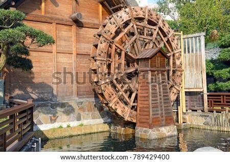vintage wooden waterwheel at...