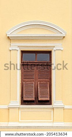 Vintage Wooden Window with shutters in colonial architecture style building