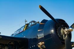 Vintage World War II aircraft cockpit and propeller.