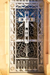 Vintage wrought iron door in cemetery