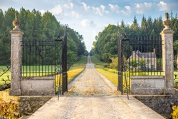 Vintage wrought iron gate and driveway in a french country house