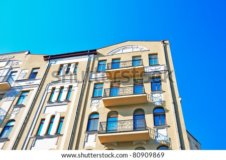 vintage yellow building over clean blue sky in a daylight