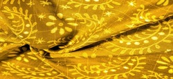 vintage yellow fabric with pale floral pattern useful for textures and backgrounds. Background texture