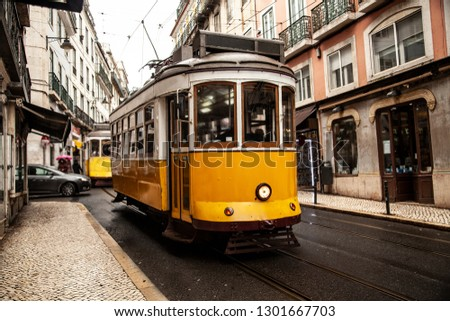 Vintage yellow tram in the city center of Lisbon in a autumn day, Portugal  #1301667703
