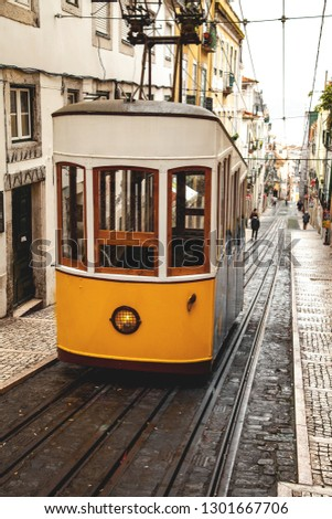 Vintage yellow tram in the city center of Lisbon in a autumn day, Portugal  #1301667706