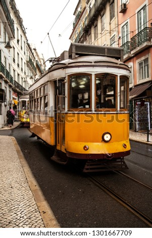Vintage yellow tram in the city center of Lisbon in a autumn day, Portugal  #1301667709