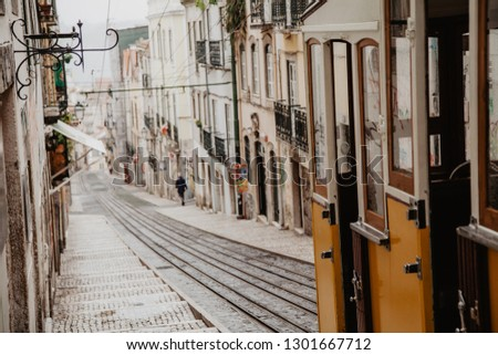 Vintage yellow tram in the city center of Lisbon in a autumn day, Portugal  #1301667712