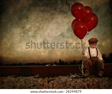 vintage young boy with red...