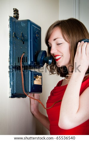 Vintage young woman talks on an antique phone