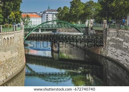 Vintage Zollamtsbrücke subway bridge and  Zollamtssteg pedestrian bridge over Danube Canal in Vienna's city center